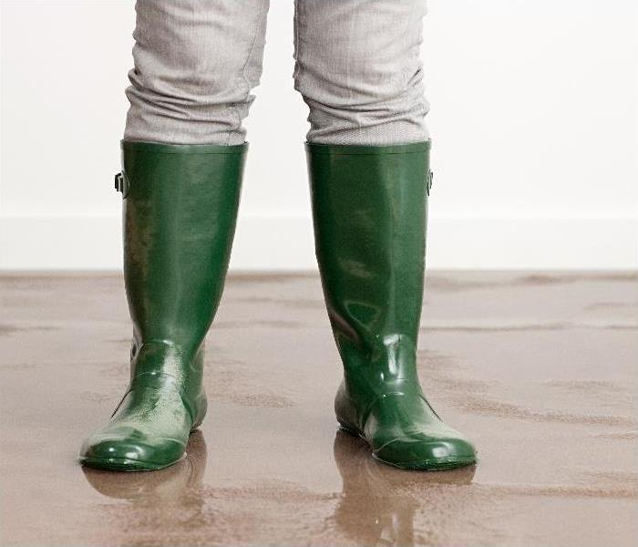 wellington boots on flooded floor