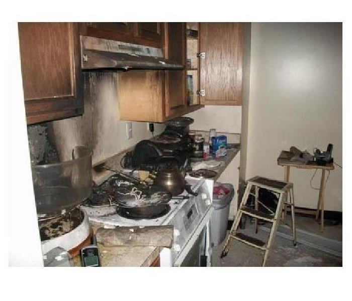 A kitchen stovetop that caught on fire