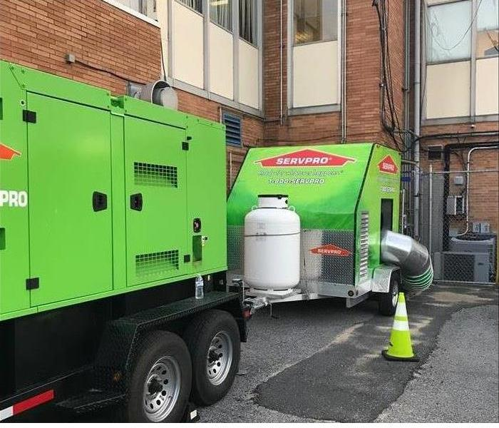 Generator and Commercial Desiccant Dehumidifier in Use