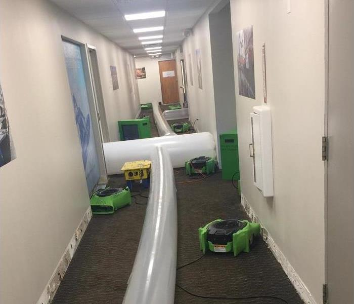 hallway of water damaged commercial building; SERPRO drying equipment drying hallway